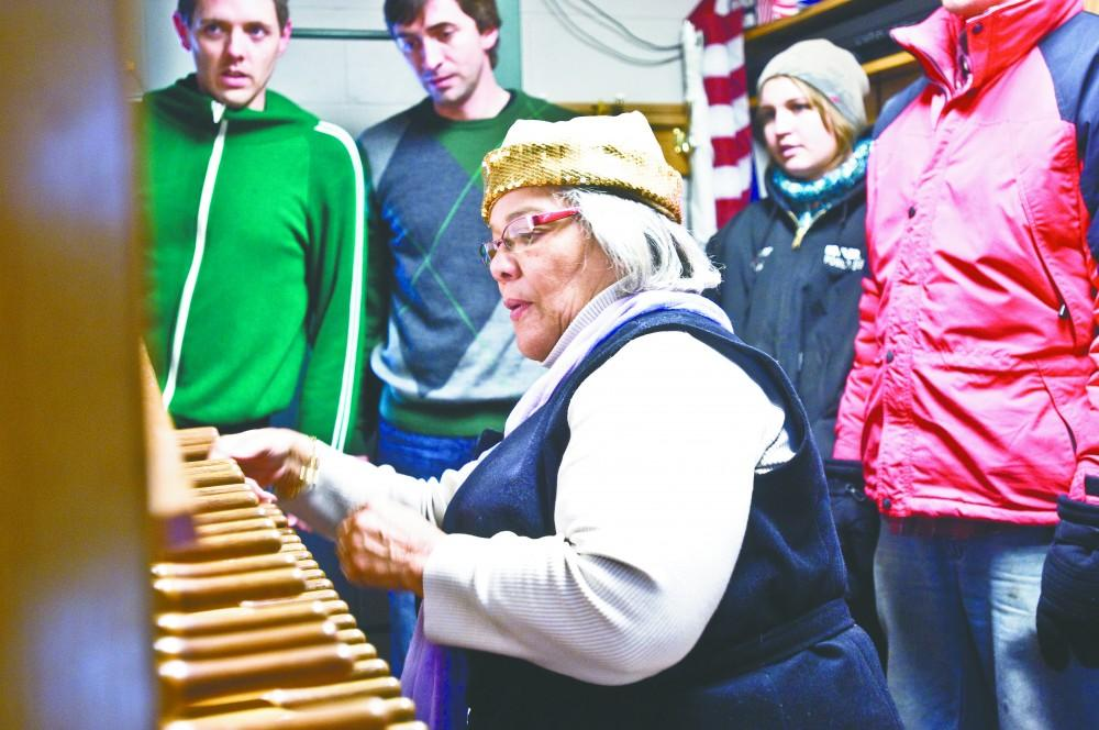 GVL/Andrew MillsJulianne Vanden Wyngaard, the university carillonneur, demonstrates the carillon inside of the Cook Tower on the Grand Valley State University Allendale campus.