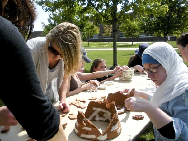 Courtesy Photo / Ashley TaylorStudent reconstruct pottery during an Archeology Week event