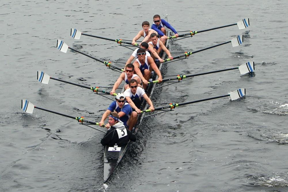 Courtesy Photo / Alex VanderarkThe Mens team slides up to the catch in unison during the Head of the Charles Regatta
