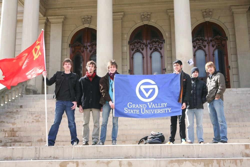 A group of Grand Valley students on the steps of the Capitol Building in Lansing, protesting lower funding for higher education