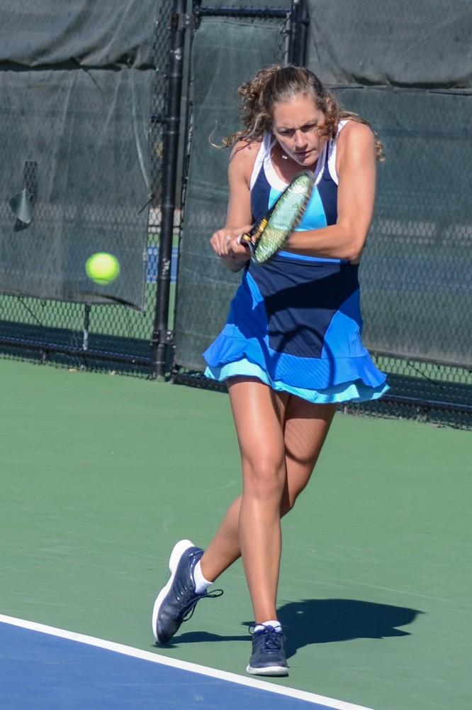 GVL / Hannah Mico. Senior Lexi Rice focuses hard on returning a volley at Saturday morning's match against Wayne State University; Rice was playing doubles with her partner Carola Orna (junior).