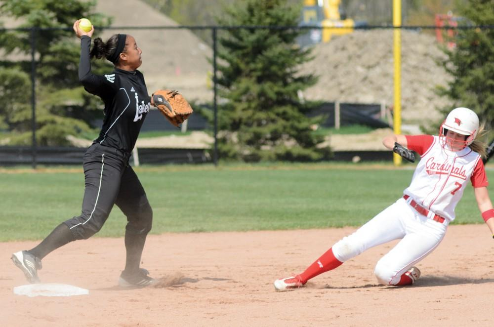 GVL / Bo AndersonShortstop Briauna Taylor fires to first to complete the double play, ending an early rally for SVSU.