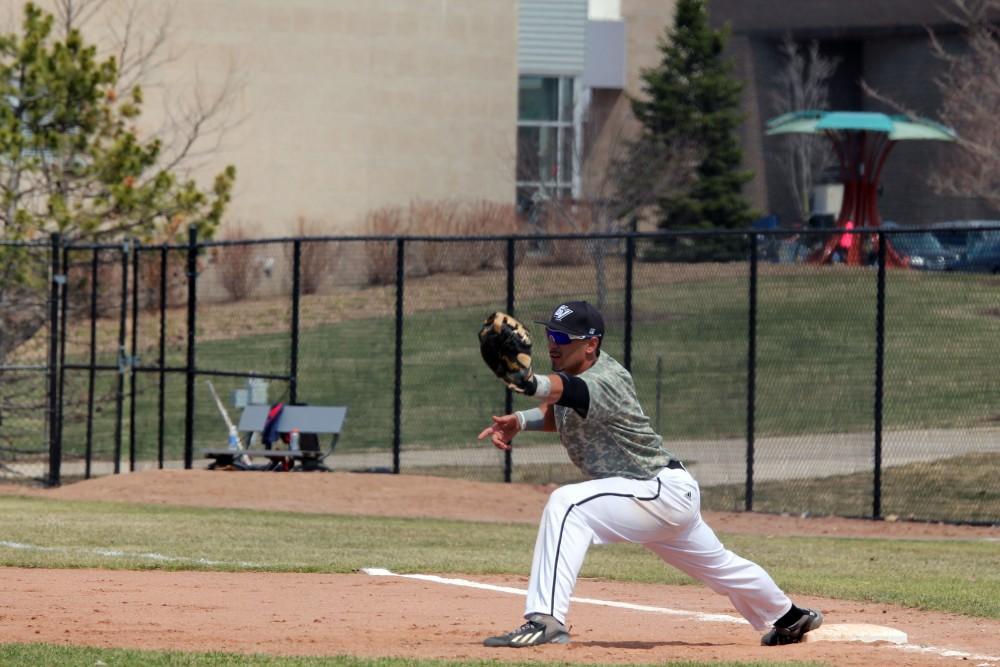 GV / Emily FryeSenior Giancarlo Brugnoni makes the play at first base
