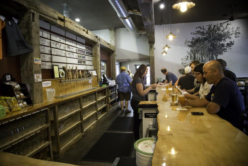 GVL/Spencer MillerTrail Point Brewing Co. Opens its doors to the public during the grand opening on Saturday, August 8, 2015. The new brewery offers 8 beers on tap, everything from a Shandy Mountain Lemon Shandy to a Tail Oatmeal Stout. The Allendale Brewery is located off of Lake Michigan Drive.