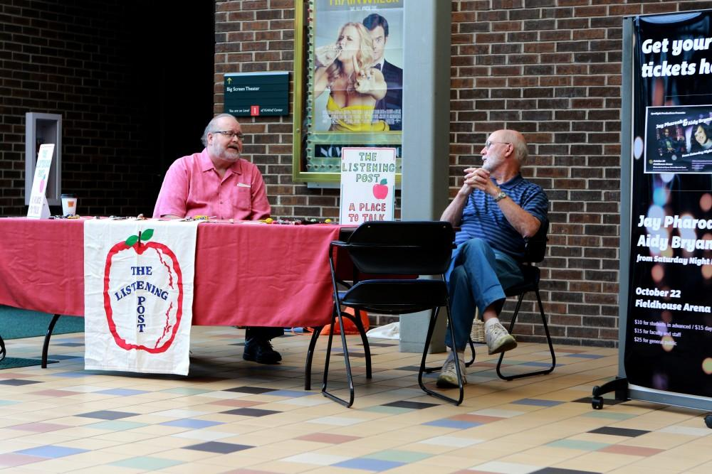 Jim Markus (left) and Dwight Hillstrom (right) wait for students to come and talk with them on Oct. 13 in Allendale, MI. The Listening Post is an on campus ministry for students to come and talk about anything on their mind.