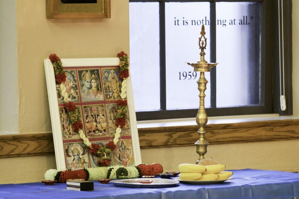 GVL / Sara CartePeople celebrate the religious tradition of the Aarti at the Interfaith Diwali Celebration at the Fountain Street Church on Oct. 30.