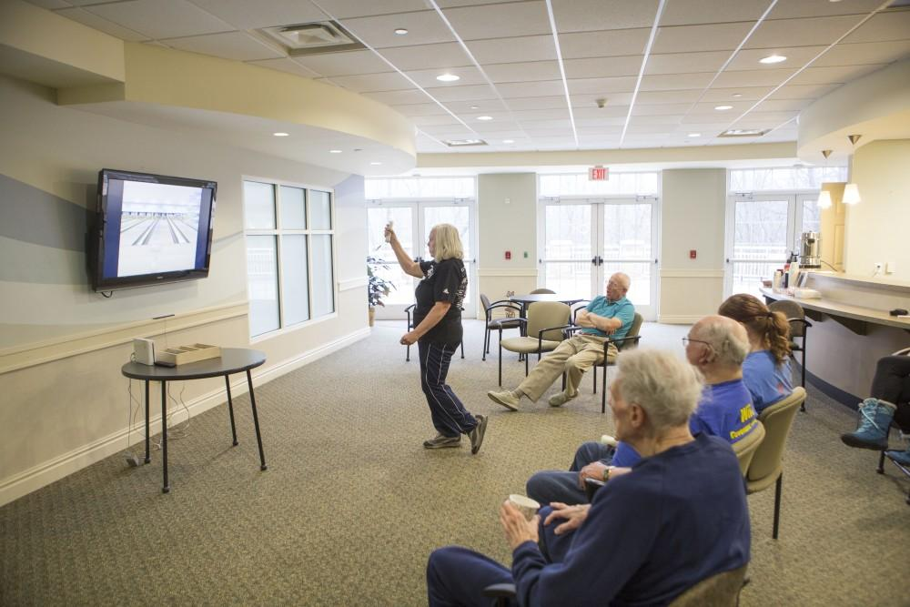 GVL / Sara Carte - Volunteer, Willma Vanderzwaag (middle), plays in the wii bowling tournament for Community Outreach Week at the Covenant Village of the Great Lakes on Thursday, Mar. 24, 2016.