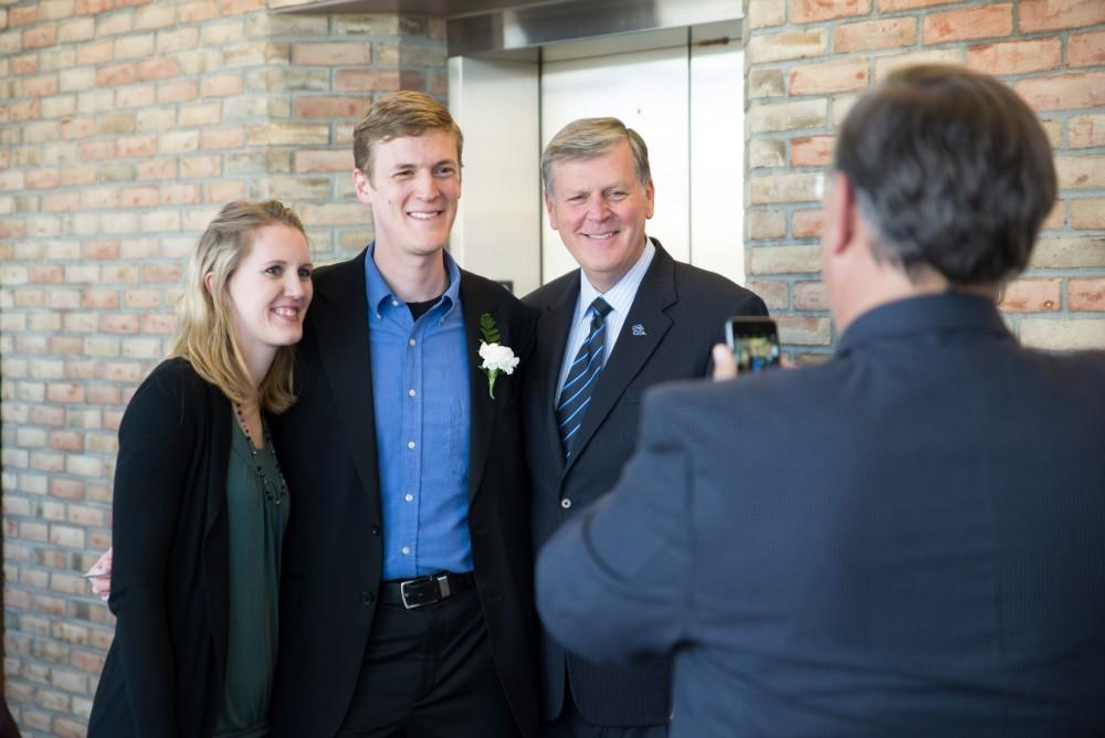 GVL / Luke Holmes - A couple of students pose for a photo with president Haas before the ceremony. The Student Convocation awards ceremony was held in the Eberhard Center Monday, Apr. 11, 2016.