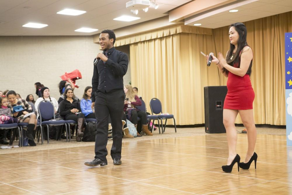 GVL / Sara CarteMarcus Jiles (left) and Leah Taylor (right) hosts Grand Valley State University's celebration of the Asian New Year Festival 2016, sponsored by the Asian Student Union and the Office of Multicultural Affaris, in the Kirkhof Center on Thursday, Feb. 4, 2016.
