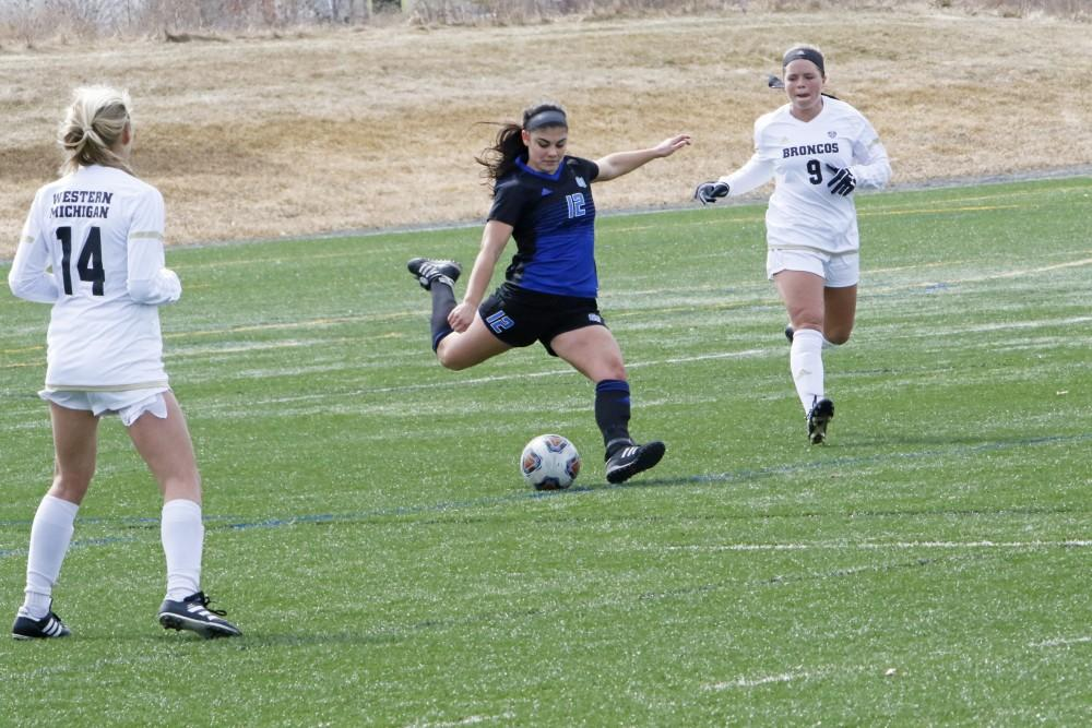 GVL / Robbie Triano    Cecilia Steinwascher takes the ball down the field during the spring opener on Saturday March 24, 2018.