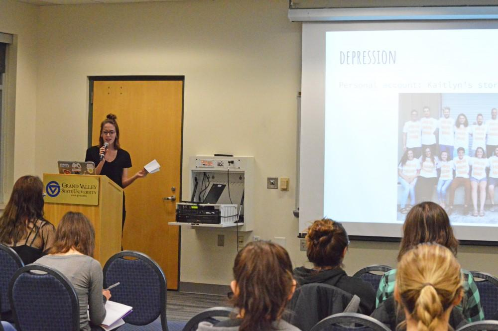 GVL / Hannah Zajac Kaitlyn Mueller speaks to the crowd during the Breaking Down Walls talk on Thursday March 29, 2018.