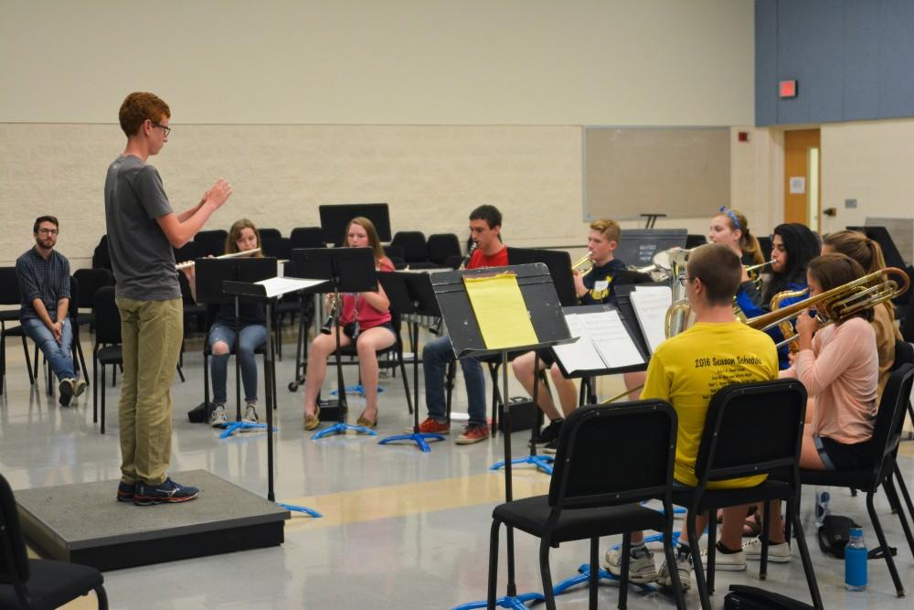 <p>A high school student conducts his fellow campers at GVSU's Servant Leadership in Music camp on June 20. </p> <p>Courtesy / Caitlin Cusack</p>