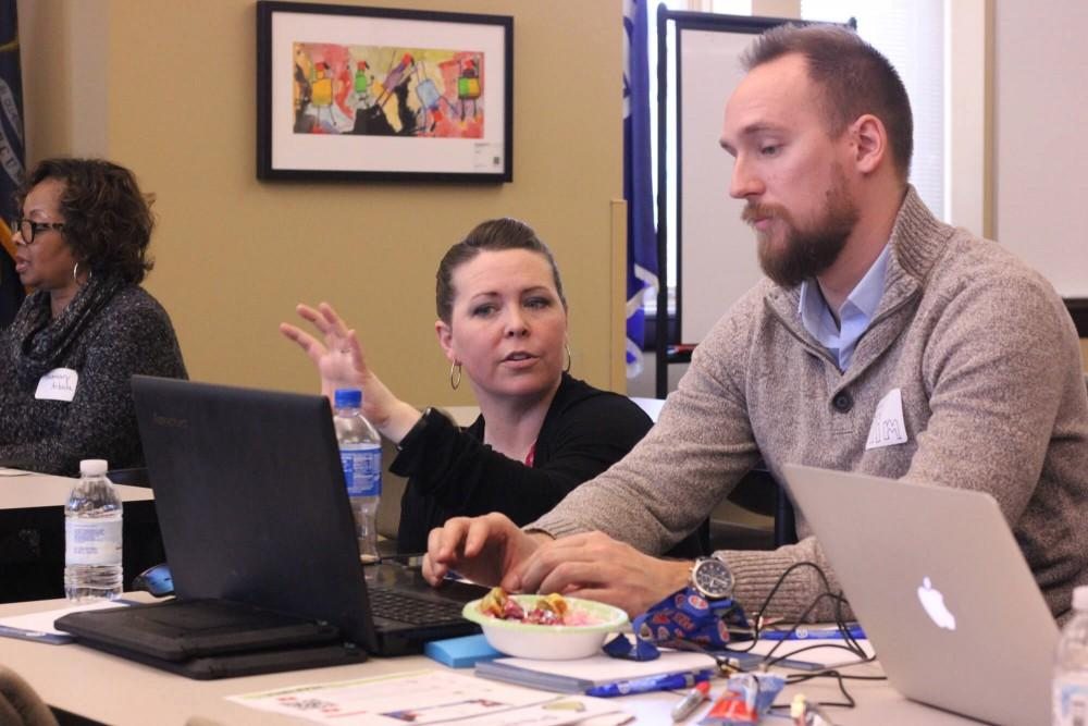 <p>A Charter Schools Office staff member works with a teacher on professional development. Courtesy / GVSU CSO</p>