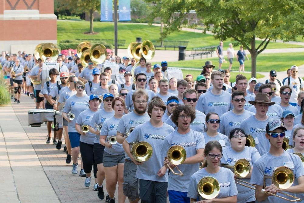 <p>The GVSU Marching Band marches to a football open scrimmage during band camp to practice a performance.  Courtesy / Lindsey Willett</p>
