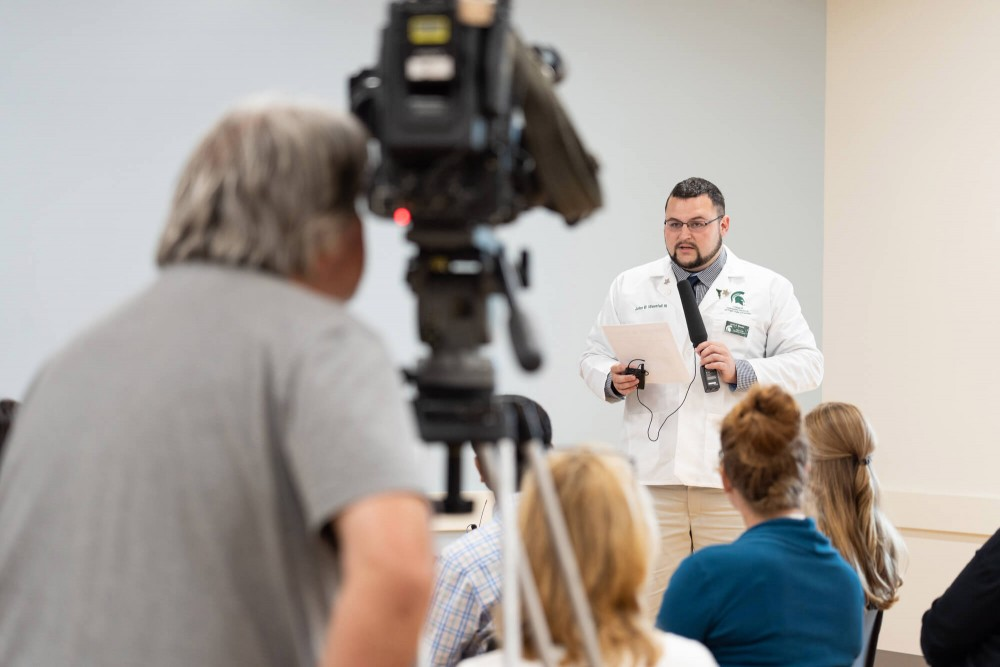 <p>John Westfall, second-year medical student and GVSU graduate, makes remarks during a news conference July 23 that outlined an early assurance of admission program. Courtesy / gvsu.edu</p>
