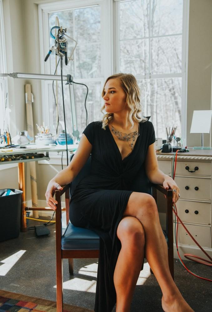 <p>Alumna Emma Hoekstra sits in her studio. Hoekstra placed top five in the Halstead Grant competition because of the successes of her jewelry business. Courtesy  /  Emma Hoekstra</p>