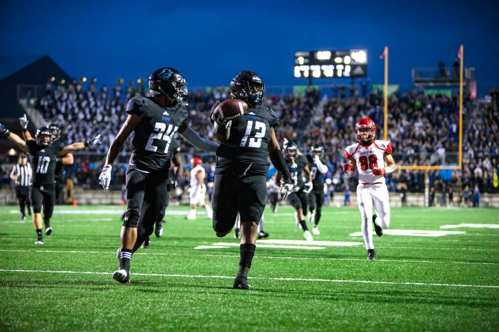 Kwanii Figueroa takes an interception to the house in a game against Dixie State on Saturday, Oct. 6. GVL / Sheila Babbitt