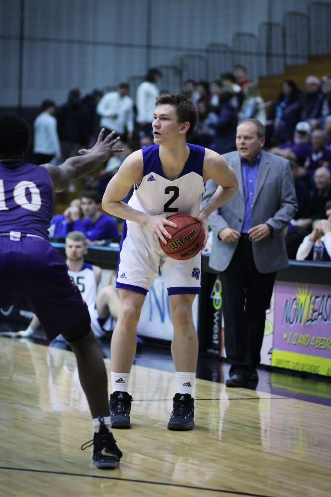 <p>Jake Van Tubbergen scans the court at the game vs Ashland on February 15th, 2018. GVL / Sheila Babbitt</p>