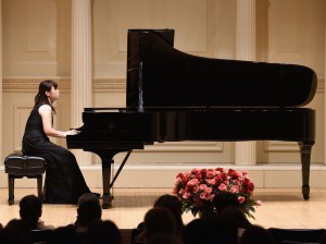 Dr. Chia-Ying Chan playing piano. Courtesy / Community Center for the Arts