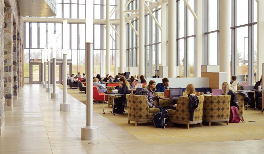 <p>Students work inside the Mary Idema Pew Library on Wednesday, March 29, 2017. GVL / Hannah Zajac </p>