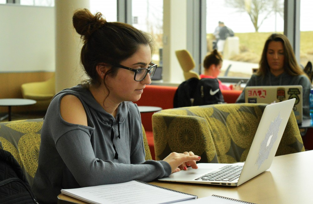 <p>GVL/Archive - Junior Theraputic Recreation student Angela Thweni works on finishing homework in the Mary Idema Pew Library on Wednesday, March 29, 2017.</p>