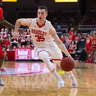 Jayden Hodgson dribbles to the hoop in a game with Bradley University. Courtesy/@jaydenhodgson35 on Twitter