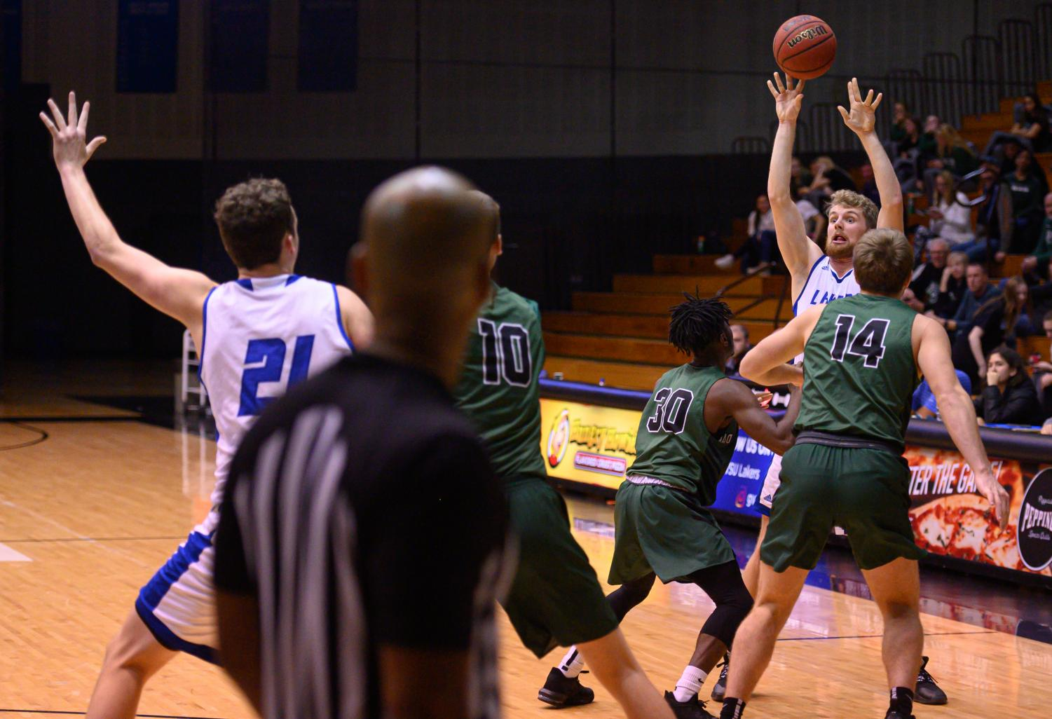 Senior  Ben Lubitz passes to freshman forward in the post in a game against Wisconsin Parkside. GVSU won the game, 73-47.