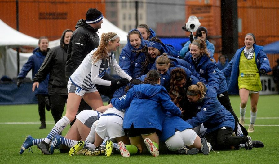 The+GVSU+Soccer+team+celebrate+following+their+2OT+victory+against+Western+Wash.+%2F%2FCOURTESY%3A+gvsulakers.com