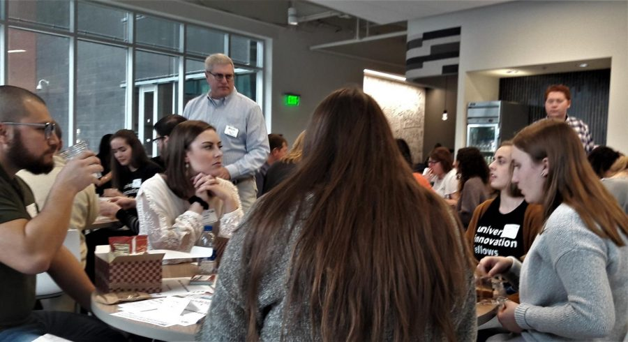 Design Thinking Director Dave Coffey watches table group discussions. GVL / Ysabela Golden