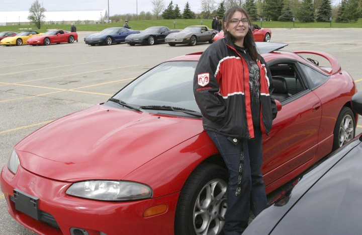 Courtesy Photo / Nicole KhanNicole Khan, president of the GVSU car club, and her 1999 Mitsubishi Eclipse GS at last year's car show.