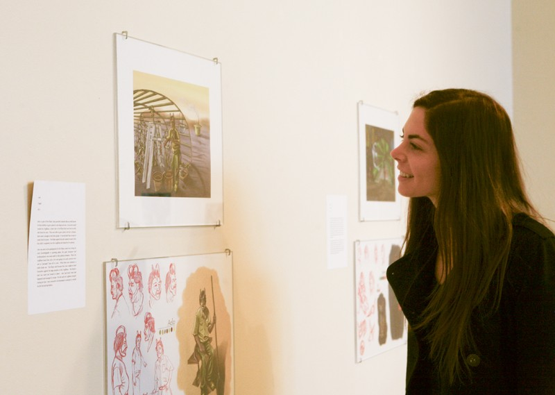 GVL/ Eric Coulter GV student Alyssa Beck enjoys Ensorcell in the Padnos Art Gallery.