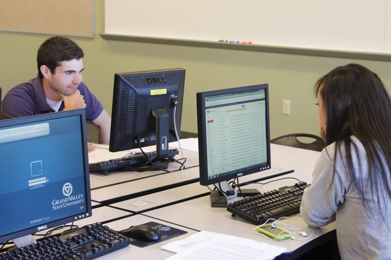 GVL / Jessica Hollenbeck Freshman Adam Terwilliger and junior Calla Van Atta works in the Niemeyer computer lab.
