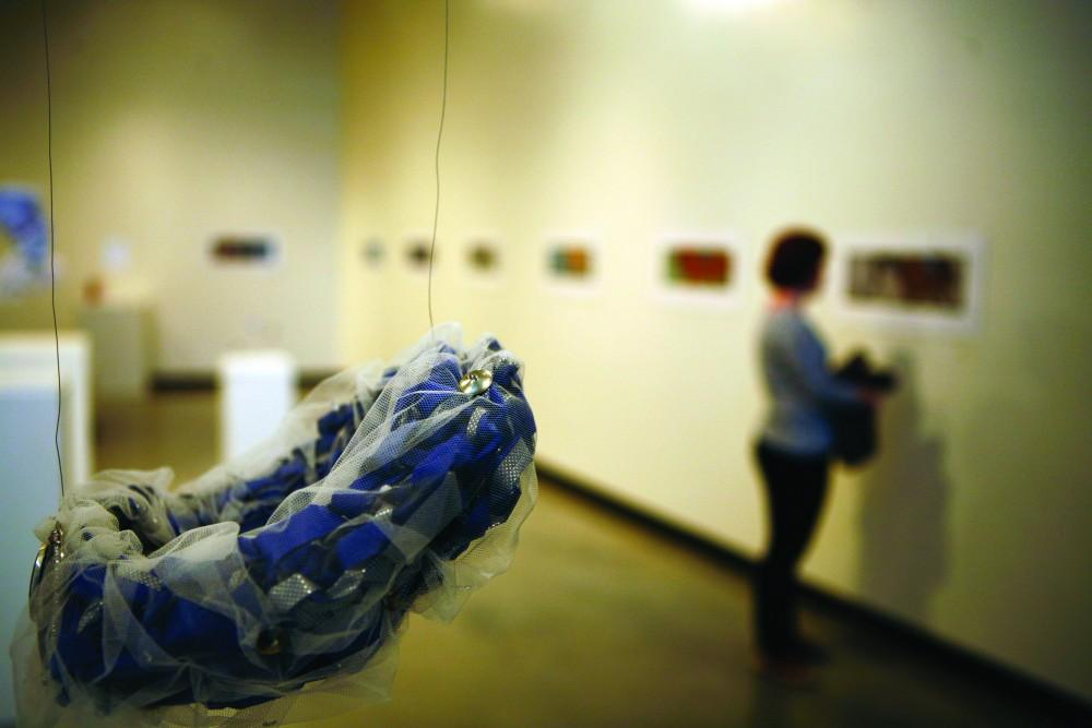 GVL / Eric CoulterGVSU Senior Thesis show Reverie in the Padnos Art Gallery will be on display through November 16th. The exhibit features work from Elizabeth Lowe, Jackie Solhoff, and Samantha Goch spanning various mediums, including illustration, textiles, and metalworking.