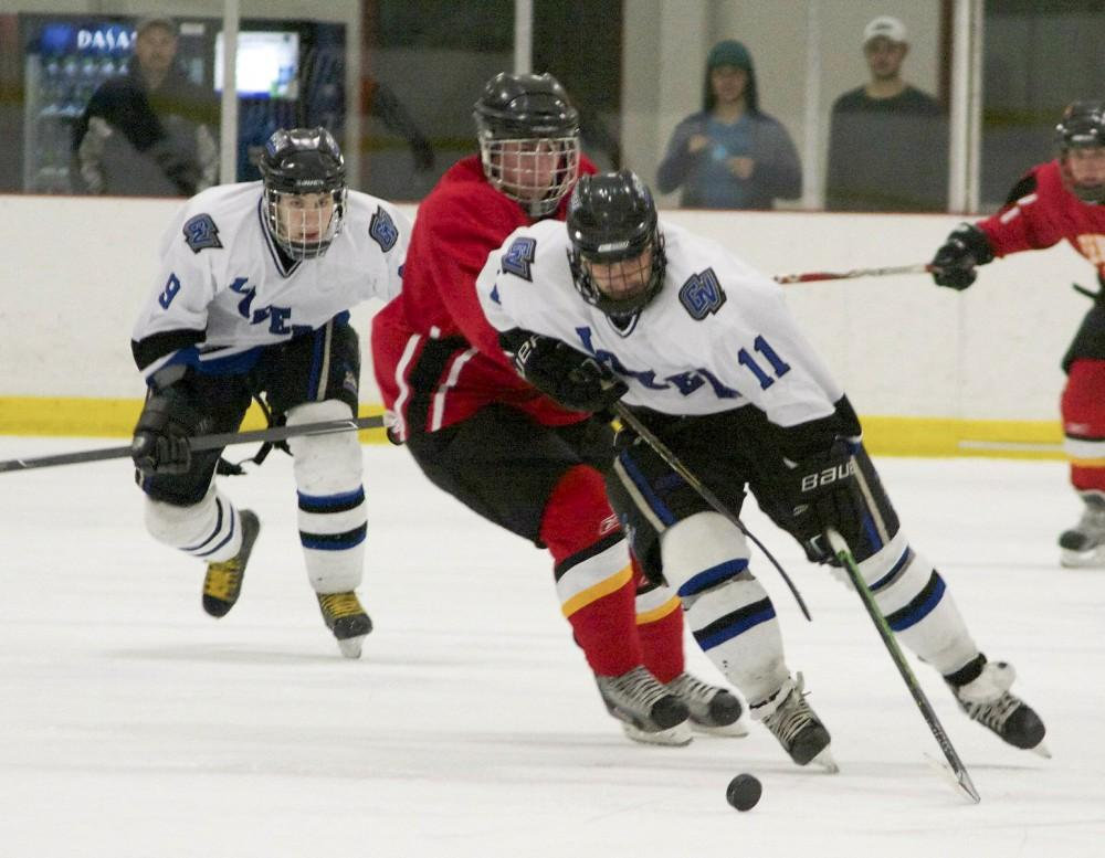 Courtesy Photo / GVSU DII Mens HockeyJeremy Christopher chases down a puck during a matchup last season.