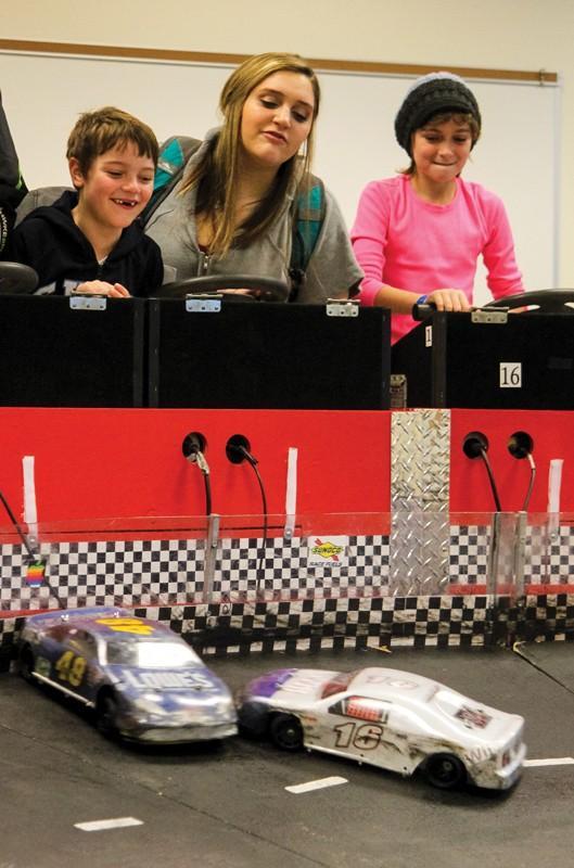 GVL/Jessica HollenbeckGVSU student Heather Knochel and her brother Lucas race against Avery Considine (sister of GVSU student Evan Considine).