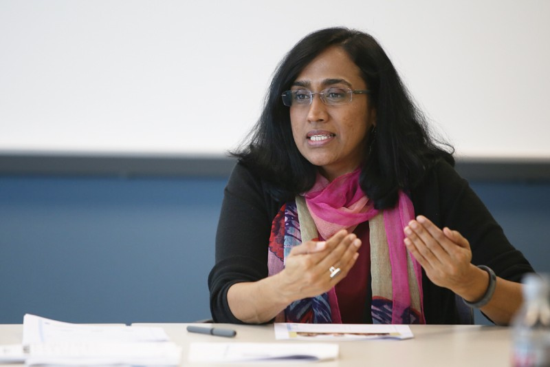 GVL / Robert MathewsShaily Menon, associate dean of the College of Liberal Arts, speaking at the Asian Women in Higher Education presentation in Kirkhof.