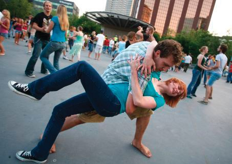 Courtesy / mlive.com A couple dance together during the weekly Tuesday night swing dance at Rosa Parks Circle in downtown Grand Rapids.