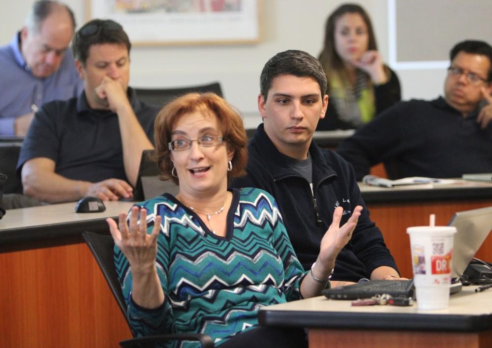 Joy Washburn with Ricardo L. Benavidez, commenting on Student Senate Report.