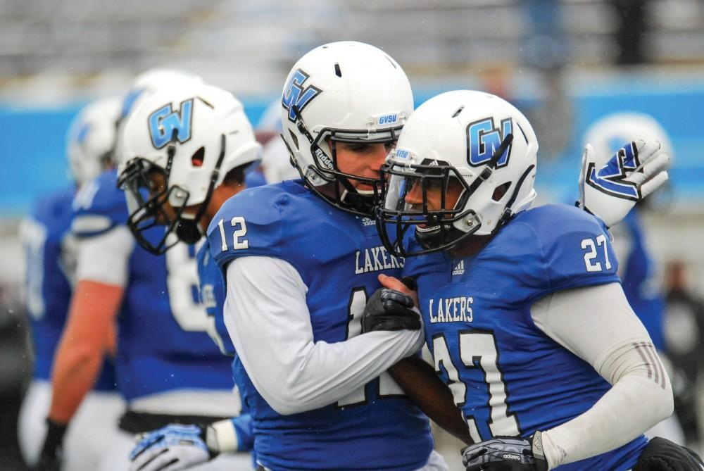 GVL / Hannah MicoHeath Parling (12) congratulates runningback Kirk Spencer (27) on his second touchdown of Saturday's game.