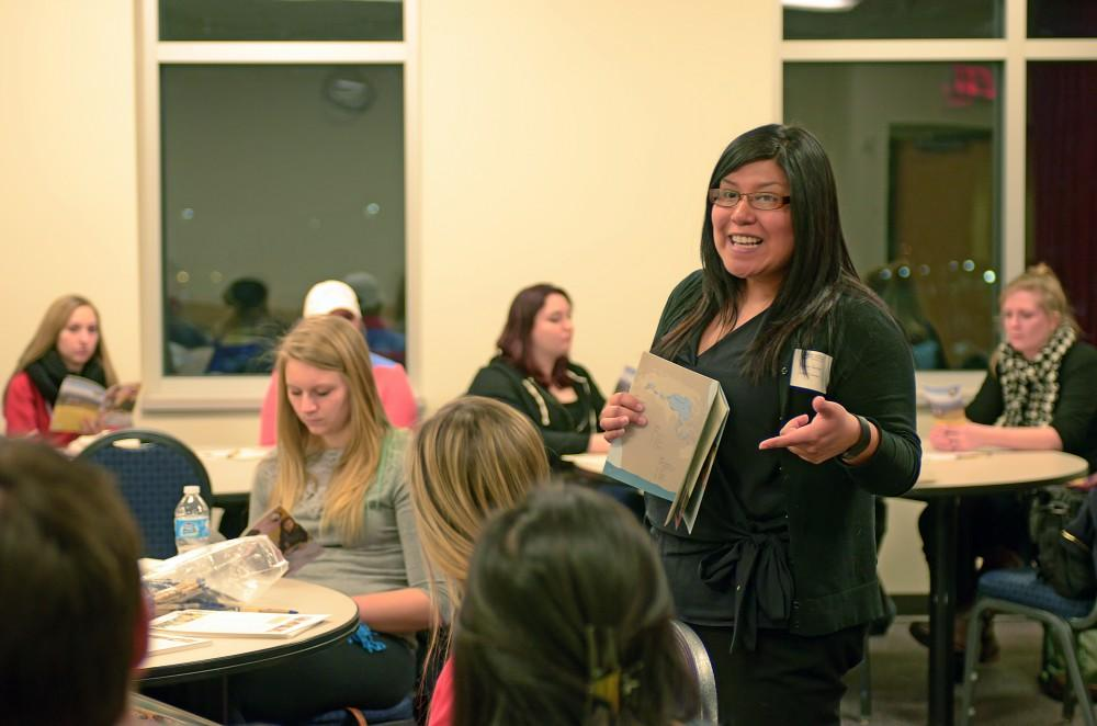 GVL/Kevin SielaffJudy Torres, volunteer for the Peace Corps, shares her experiences with a group of aspiring Grand Valley students.