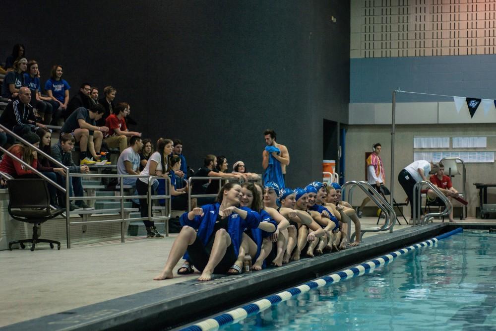 GVL / Mohamed AzuzSwimmers cheer on their team mates at a meet earlier this season.