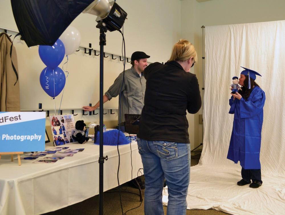 GVL / ArchiveDan Dixon and Heather Dixon photograph Stephanie Labby at their Grad Fest Booth