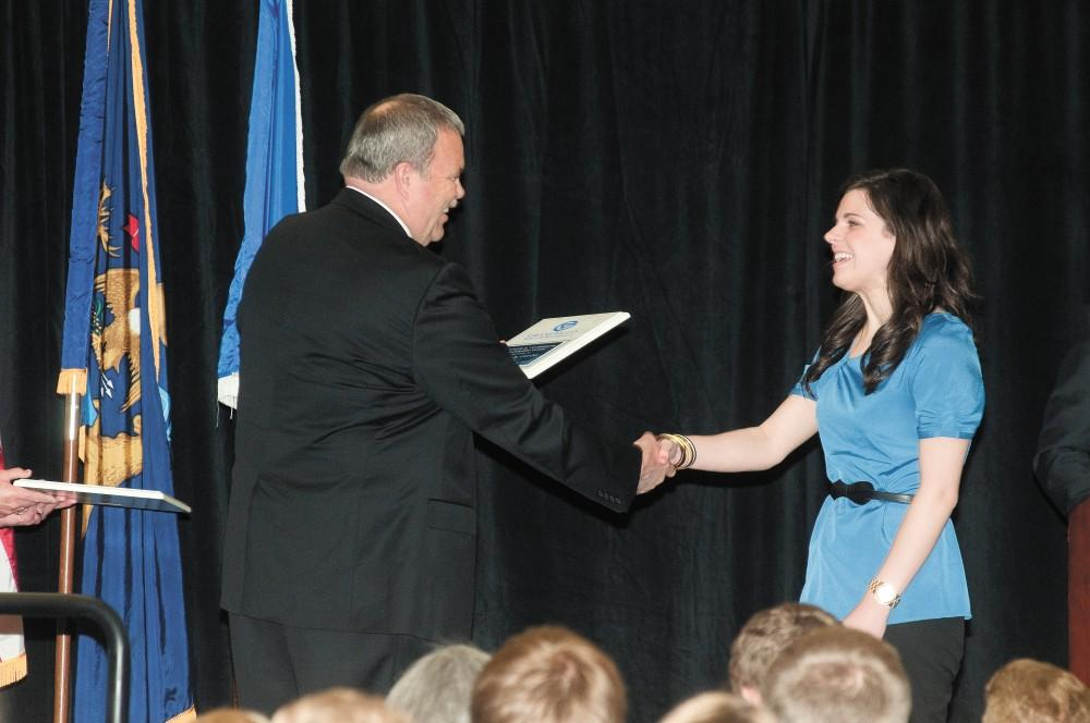 GVL / Courtesy - News and Information Services Former student Natalie Cleary accepts an award from Dean of Students Bart Merkle