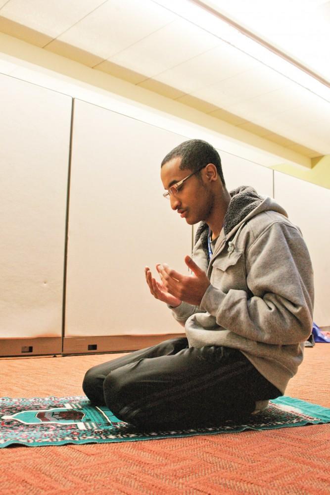 GVL / ArchiveFormer student Mohamed Mohamed prays in Kirkhoff (2012)