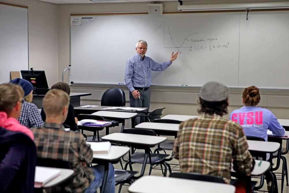 GVL / Emily Frye Professor George McBane, Ph.D., begins teaching his physical chemistry class on Oct. 9th. Professor McBane is the head of the chemistry department here at Grand Valley State University and also continues to conduct outside research.