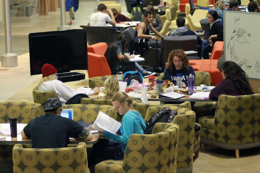 Students work in groups at the Mary Idema Pew Library on Nov. 3 in Allendale, MI.