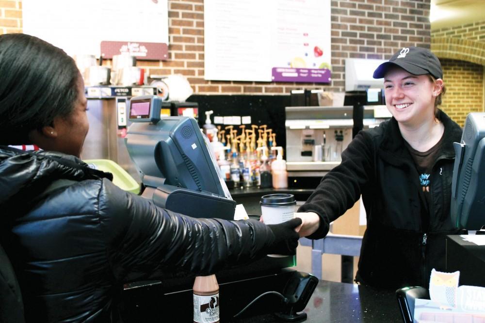 GVL / Emily FryeLobby Shop worker Kayla Guercio serves Taylar Dickson