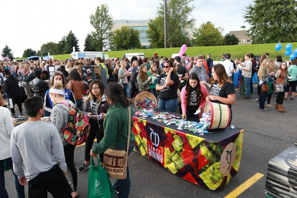 GVL/Kevin SielaffCampus Dining gives out free candy to people passing by their stand. Campus Life Night takes place Sept. 13, 2015 on the grounds of parking lot H at Grand Valleys Allendale campus.