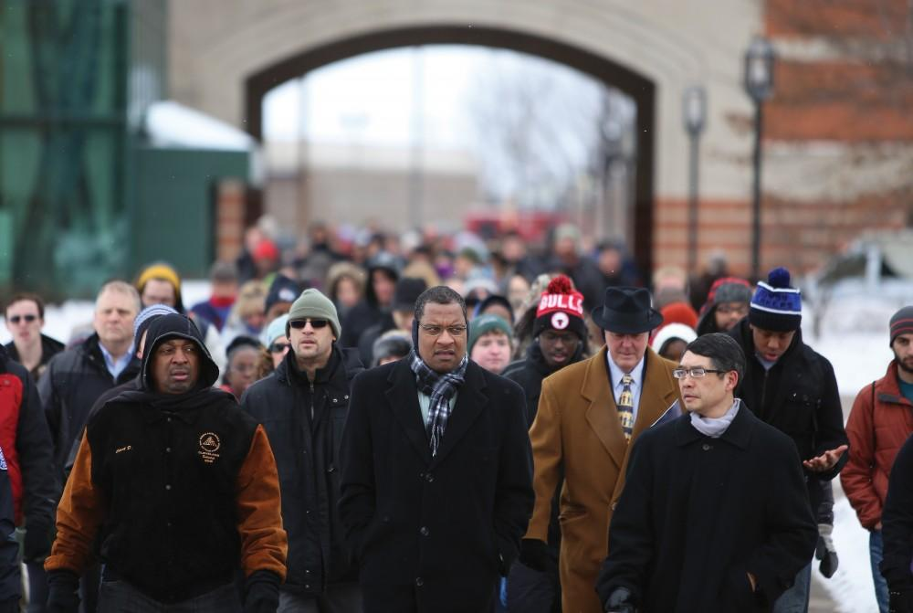 GVL / ArchiveChuck D and co-chairs Bobby Springer and Kin Ma and many others participate in the silent march as a part of Grand Valley State Universitys Martin Luther King Jr. Day events on Monday, January 20, 2014.