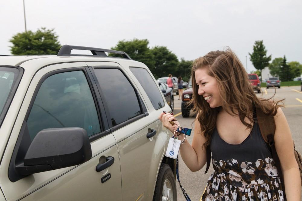 GVL / Sara CarteGrand Valley student, Bethany Garcia, locks her car on her way to class on Tuesday, September 8, 2015.